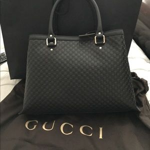Gucci black leather Guccissima top handle tote